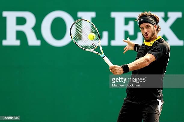 Feliciano Lopez of Spain returns a shot to Philipp Kohlschreiber of Germany during the Shanghai Rolex Masters at the Qi Zhong Tennis Center on...