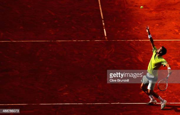 Feliciano Lopez of Spain serves against Federico Delbonis of Argentina in their first round match during day three of the Mutua Madrid Open tennis...