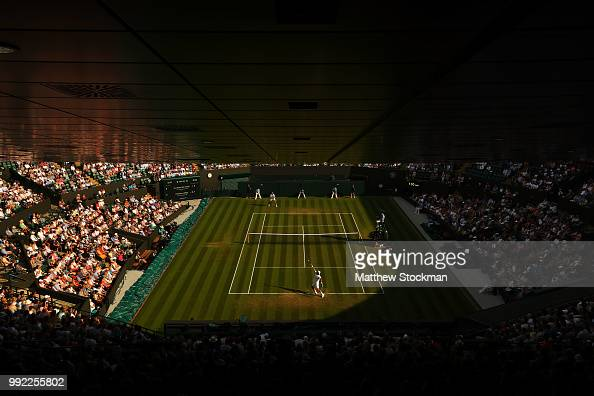 Feliciano Lopez of Spain serves against Juan Martin del Potro of Argentina during their Men's Singles second round match on day four of the Wimbledon...