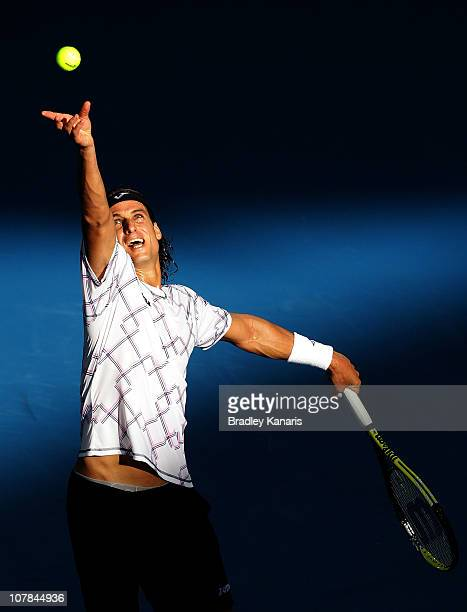 Feliciano Lopez of Spain serves during his first round match against Philipp Petzschner of Germany during day one of the Brisbane International at...