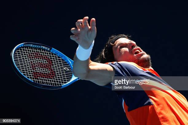Feliciano Lopez of Spain serves in his first round match against Sam Querrey of the United States on day two of the 2018 Australian Open at Melbourne...