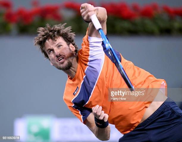 Feliciano Lopez of Spain serves in his match against Jack Sock of the United States during the BNP Paribas Open at the Indian Wells Tennis Garden on...