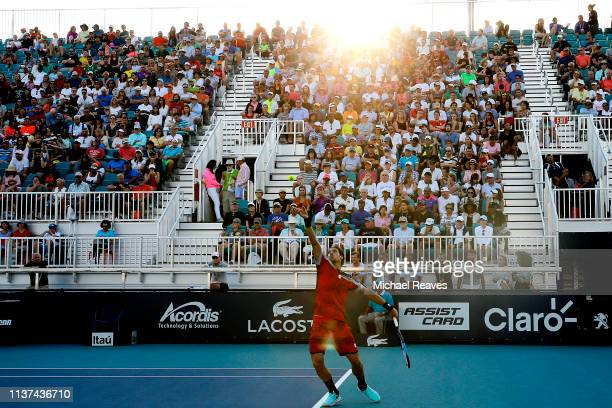 Feliciano Lopez of Spain serves to Benoit Paire of France during Day 4 of the Miami Open Presented by Itau at Hard Rock Stadium on March 21, 2019 in...