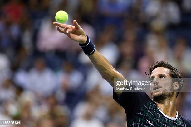 Feliciano Lopez of Spain serves to Novak Djokovic of Serbia during their Men's Singles Quarterfinals match on Day Nine of the 2015 US Open at the...