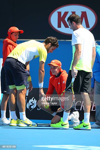 Feliciano Lopez of Spain speaks to a ball kid that got struck by a serve in his second round match against Adrian Mannarino of France during day four...