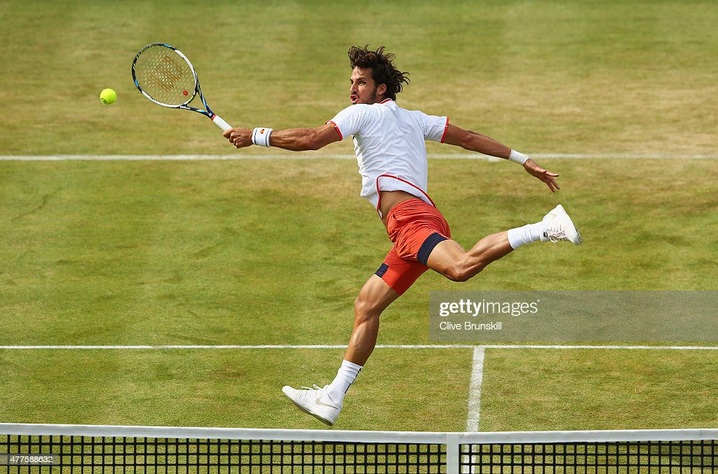 Feliciano Lopez of Spain volleys in his men's singles second round match against John Isner of USA during day four of the Aegon Championships at Queen's Club on June 18, 2015 in London, England.