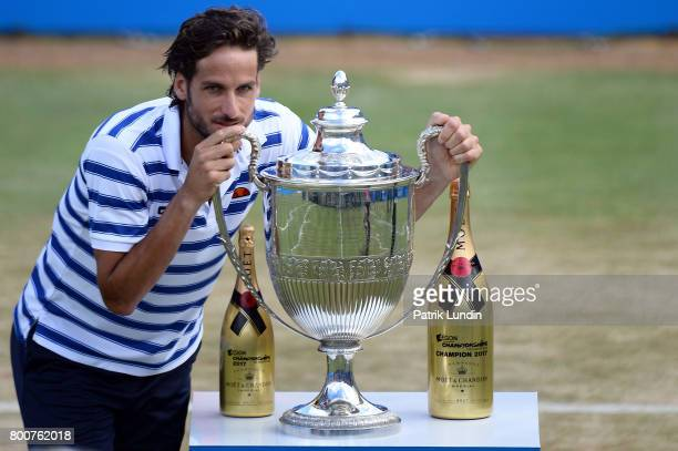 Feliciano Lopez of Spain with the trophy after victory during the Final match against Marin Cilic of Croatia on day seven at Queens Club on June 25...
