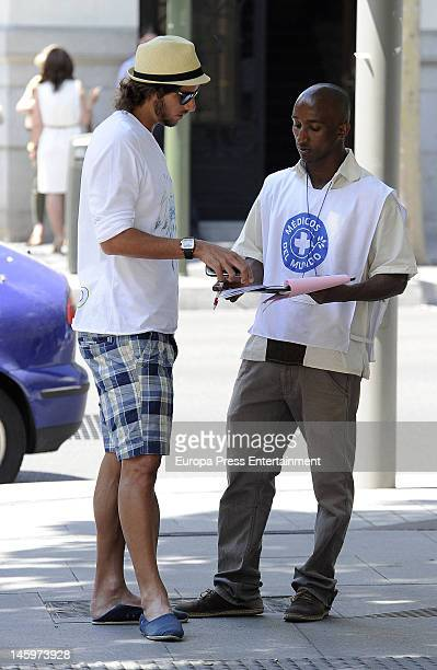 Feliciano Lopez sighted talking to 'Doctors Without Borders' member on June 7 2012 in Madrid Spain