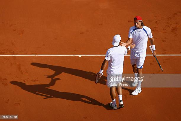 Feliciano Lopez supports Fernando Verdasco of Spain in their doubles match against Nicolas Almagro and Marcel Granollers of Spain during the Open...
