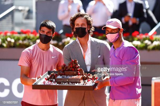 Feliciano Lopez, Tournament Director, and Rafael Nadal give a birthdate cake to Carlos Alcaraz of Spain during the ATP Masters 1000 - Mutua Madrid...