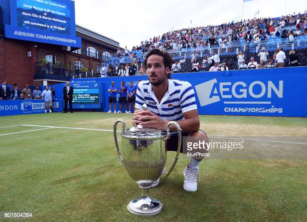 Feliciano Lopez with Trophy after during Men's Doubles Final match on the day seven of the ATP Aegon Championships at the Queen's Club in west London...