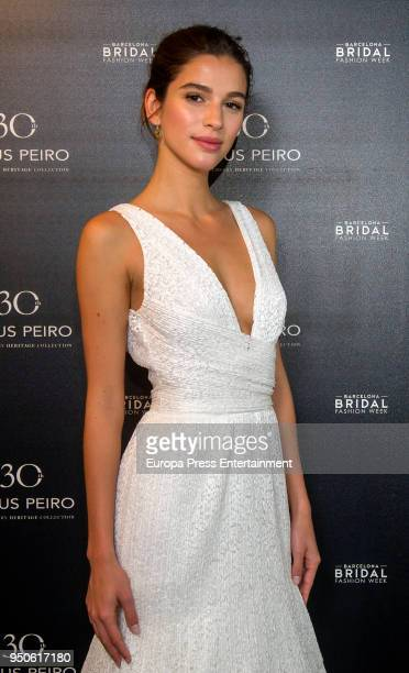 Feliciano Lopez's girlfriend Sandra Gago poses at a photocall for Jesus Peiro collection during Barcelona Bridal Fashion Week at Fira de Barcelona on...