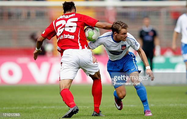 Felicio Brown Forbes of Oberhausen and Christian Essig of Heidenheim battle for the ball during the Third League match between RW Oberhausen and 1....