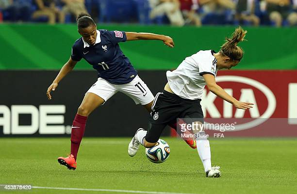 Felicitas Rauch of Germany and Lindesy Thomas of France battle for the ball during the FIFA U20 Women's World Cup 2014 semi final match between...