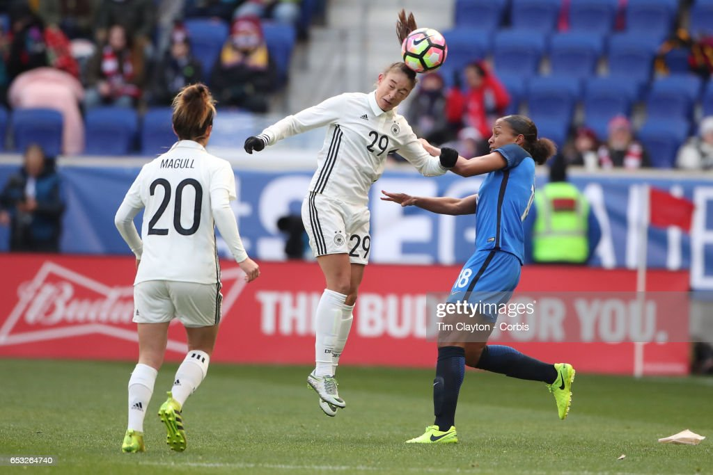 Felicitas Rauch #29 of Germany challenged by Marie-Laure Delie #18 of France during the France Vs Germany SheBelieves Cup International match at Red Bull Arena on March 4, 2017 in Harrison, New Jersey.