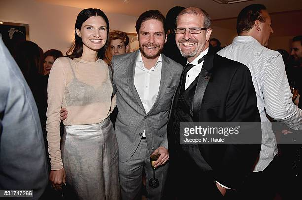 Felicitas Rombold actor Daniel Bruhl and Raindance Film Festival's Elliot Grove attend IMDb's 2016 Dinner Party In Cannes at Restaurant Mantel on May...