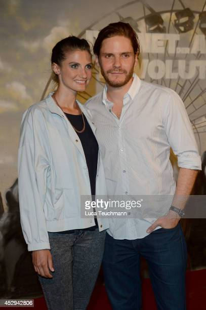 Felicitas Rombold and Daniel Bruehl attend a special preview for the film 'Dawn of the Planet of the Apes' at Freizeitpark Spreepark on July 30 2014...