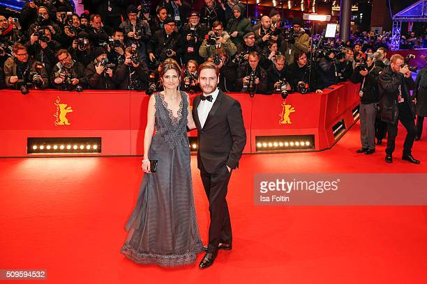 Felicitas Rombold and Daniel Bruehl attend the 'Hail Caesar' Premiere during the 66th Berlinale International Film Festival on February 11 2016 in...