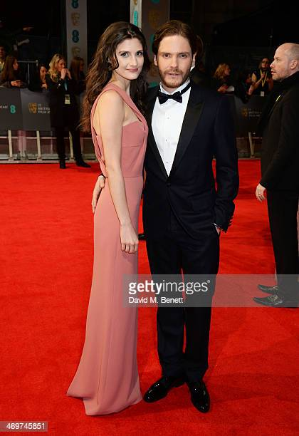 Felicitas Rombold and Daniel Bruhl attend the EE British Academy Film Awards 2014 at The Royal Opera House on February 16 2014 in London England