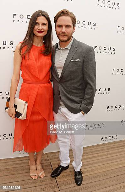 Felicitas Rombold and Daniel Bruhl attend the Focus Features Toast during the Cannes Film Festival 2016 on May 13 2016 in Cannes France