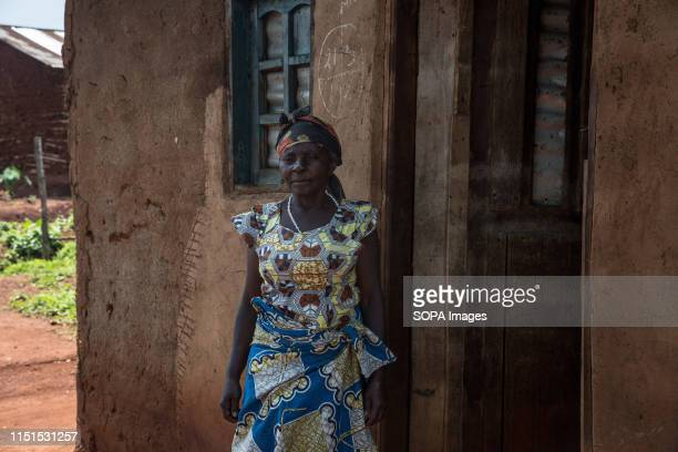 Felicite a schoolteacher watches as her home is being decontaminated after a pastor living in the house tested positive for Ebola in Beni The DRC is...