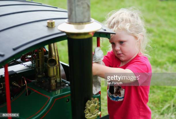 Felicity Barnfather from Swainby helps to clean a miniature steam engine during the Duncombe Park Steam Rally on July 1 2017 in Helmsley United...