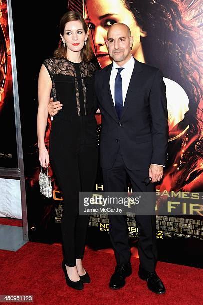 Felicity Blunt and actor Stanley Tucci attend the Hunger Games Catching Fire New York Premiere at AMC Lincoln Square Theater on November 20 2013 in...