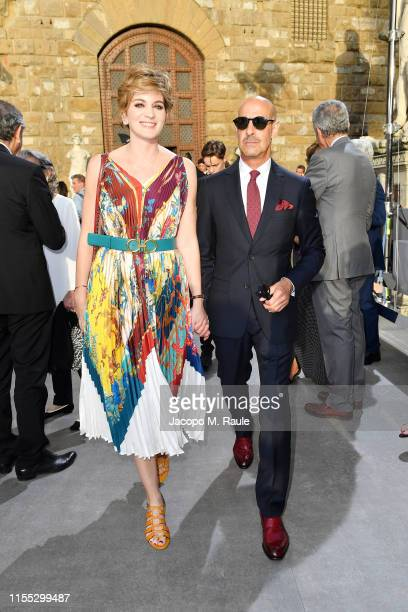 Felicity Blunt and Stanley Tucci attend the Salvatore Ferragamo show during Pitti Immagine Uomo 96 on June 11, 2019 in Florence, Italy.