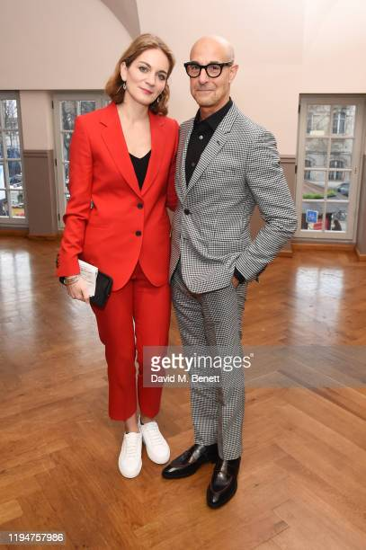 Felicity Blunt wearing Paul Smith and Stanley Tucci wearing Paul Smith attend the Paul Smith AW20 50th Anniversary show as part of Paris Fashion Week...