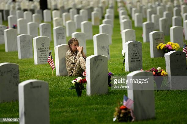 Felicity Bohn 11 of Littleton visits the grave of Gregory P. Rund USMC. He was a close high school friend of her mother Lauren where they were...