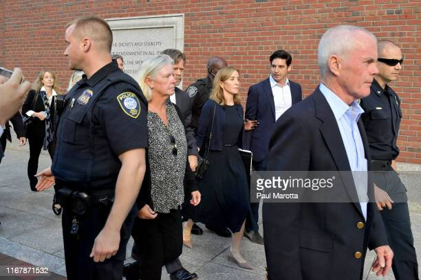 Felicity Huffman and husband William Macy exit John Moakley U.S. Courthouse where Huffman received a 14 day sentence for her role in the college...