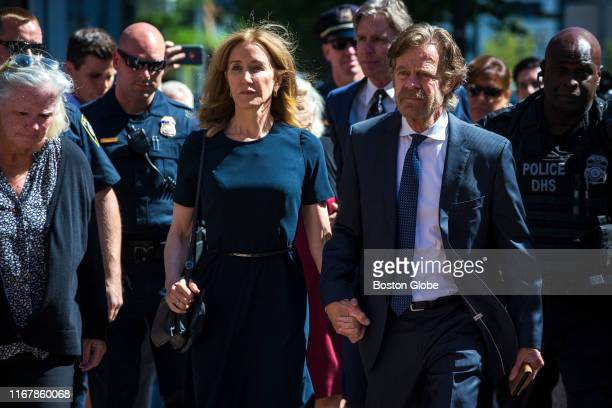 Felicity Huffman arrives with her husband William H. Macy at John Joseph Moakley US Courthouse in Boston on Sept. 13, 2019.