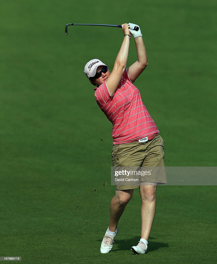 Felicity Johnson of England plays her second shot at the par 4, 14th hole during the final round of the 2012 Omega Dubai Ladies Masters on the Majilis Course at the Emirates Golf Club on December 8, 2012 in Dubai, United Arab Emirates.