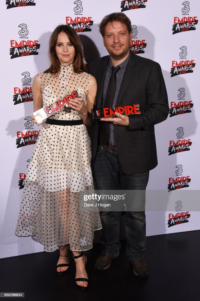 Felicity Jones and director Gareth Edwards pose with the awards for Best Actress and Best Director for Rogue One: A Star Wars Story in the winners room at the THREE Empire awards at The Roundhouse on March 19, 2017 in London, England.