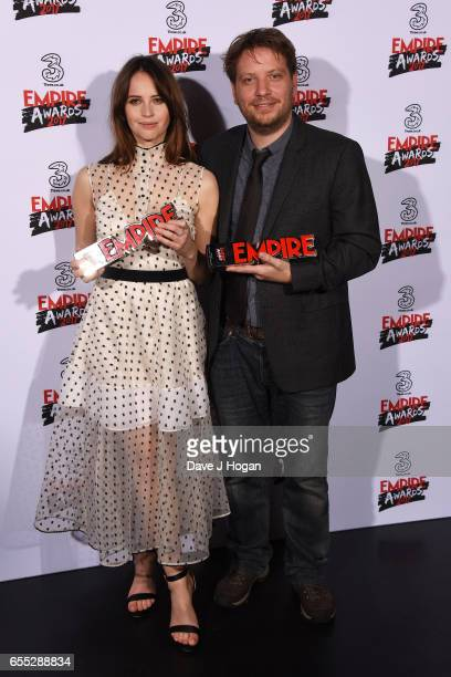 Felicity Jones and director Gareth Edwards pose with the awards for Best Actress and Best Director for Rogue One A Star Wars Story in the winners...