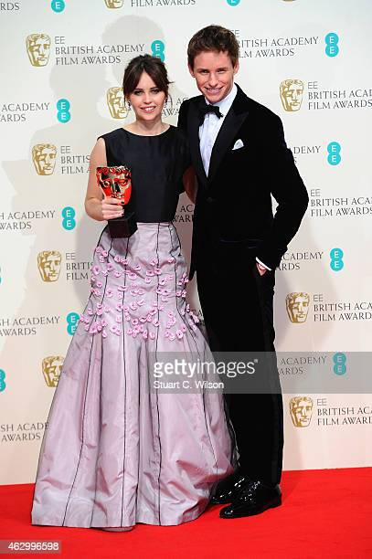 Felicity Jones and Eddie Redmayne pose in the winners room at the EE British Academy Film Awards at The Royal Opera House on February 8 2015 in...