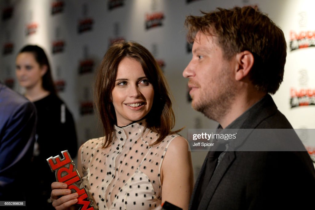 Felicity Jones (L) and Gareth Edwards pose in the winners room with the awards for Best Actress and Best Film at the THREE Empire awards at The Roundhouse on March 19, 2017 in London, England.
