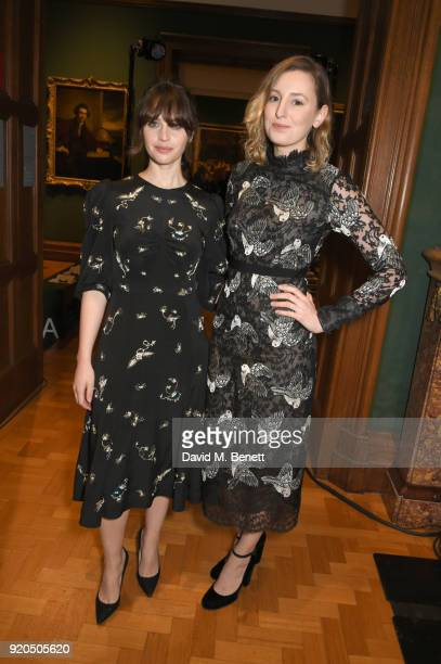 Felicity Jones and Laura Carmichael attend the Erdem show during London Fashion Week February 2018 at National Portrait Gallery on February 19 2018...