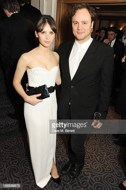 Felicity Jones and Nicholas Kirkwood attend a drinks reception at the 58th London Evening Standard Theatre Awards in association with Burberry at The...