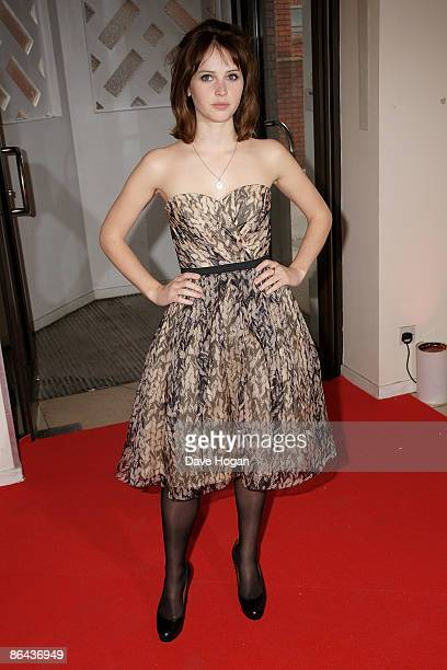 Felicity Jones attends the UK Premiere of 'Cheri' held at The Cine lumiere Institut Francais South Kensington on May 06 2009 in London England