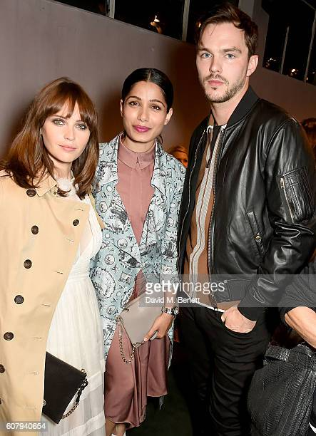 Felicity Jones Nicholas Hoult and Freida Pinto wearing Burberry at the Burberry September 2016 show during London Fashion Week SS17 at Makers House...
