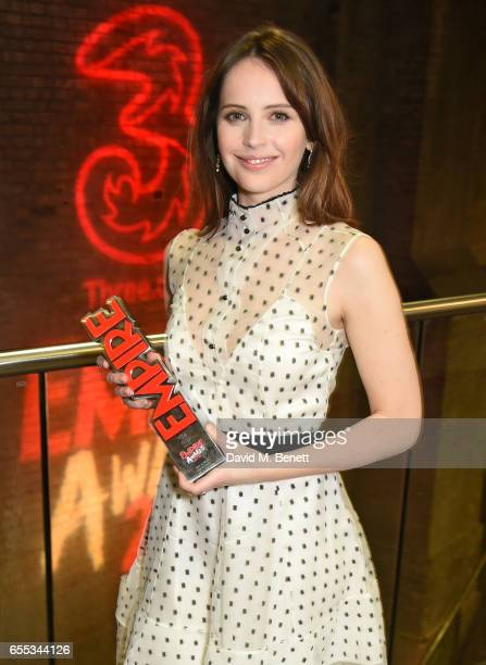 Felicity Jones poses in the winners room at the THREE Empire awards at The Roundhouse on March 19 2017 in London England