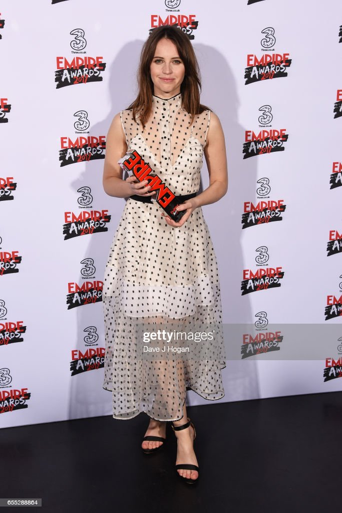 Felicity Jones poses with the award for Best Actress for Rogue One: A Star Wars Story in the winners room at the THREE Empire awards at The Roundhouse on March 19, 2017 in London, England.