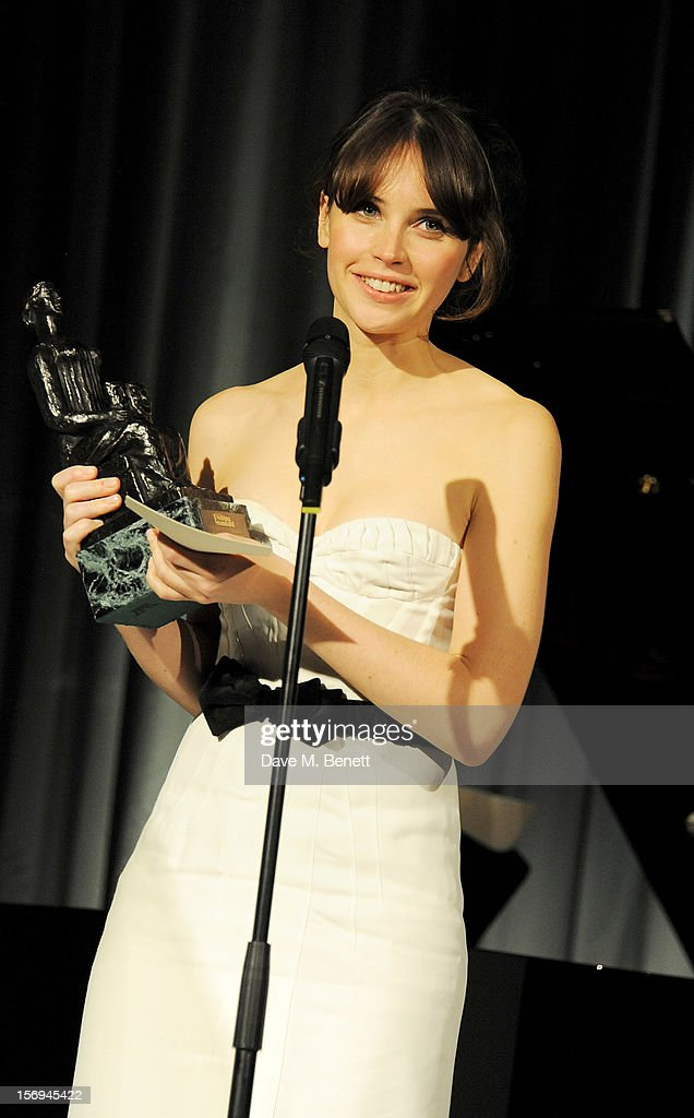 Felicity Jones presents the Milton Shulman Award for Outstanding Newcomer at the 58th London Evening Standard Theatre Awards in association with Burberry at The Savoy Hotel on November 25, 2012 in London, England.