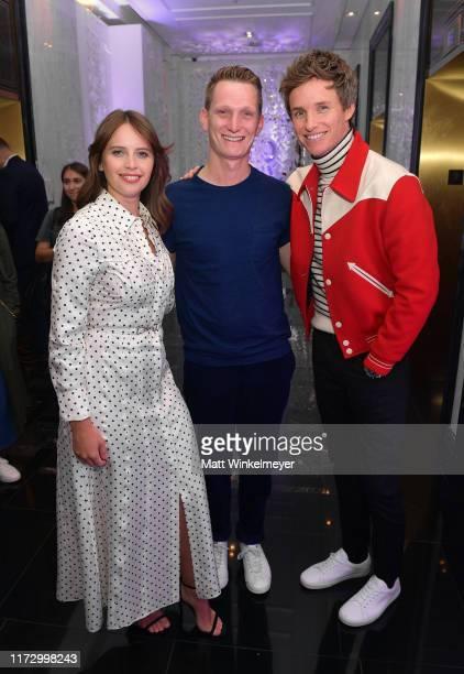 Felicity Jones Tom Harper and Eddie Redmayne attend The Hollywood Reporter TIFF Studio presented by St Regis MAC and Martell at The St Regis Toronto...