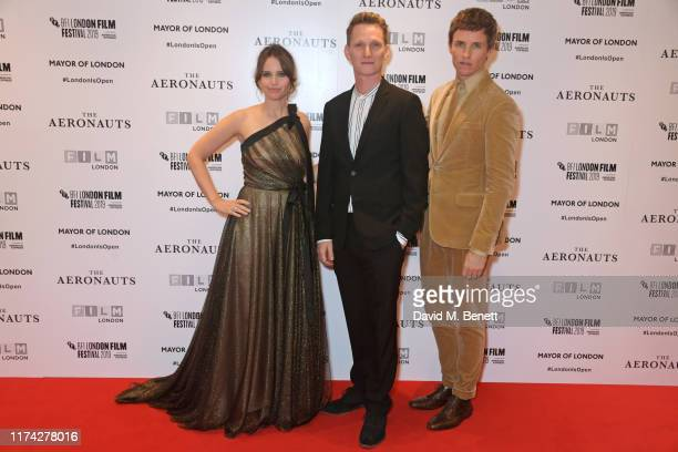 Felicity Jones Tom Harper and Eddie Redmayne attend the UK Premiere of The Aeronauts during the 63rd BFI London Film Festival at Odeon Luxe Leicester...