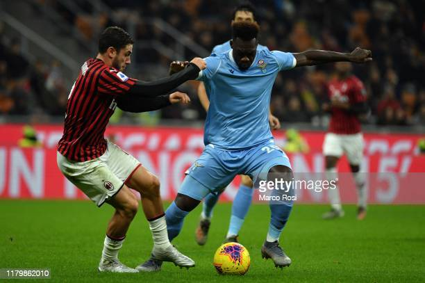 Felioe Caicedo of SS Lazio compete for the ball with Davide Calabria of AC Milan during the Serie A match between AC Milan and SS Lazio at Stadio...
