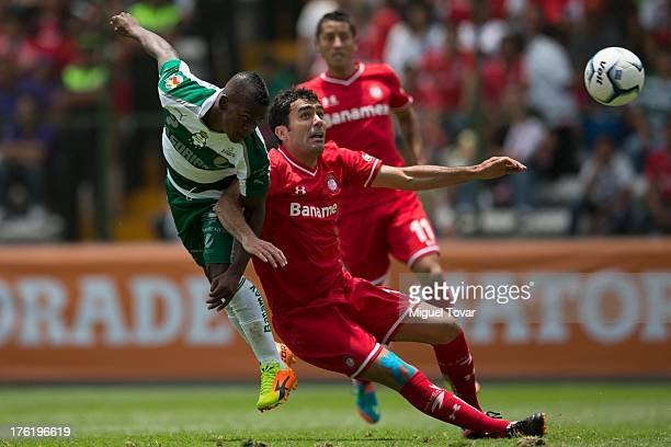 Felipe Abdiel Baloy of Santos fights for the ball during a match between Toluca and Santos as part of the Apertura 2013 Liga MX at Nemesio Diez...