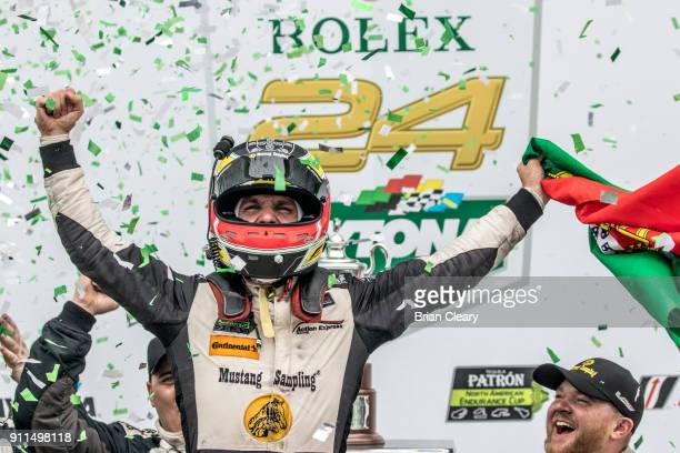 Felipe Albuquerque of Portugal celebrates in victory lane after winning the Rolex 24 at Daytona IMSA WeatherTech Series race at Daytona International...