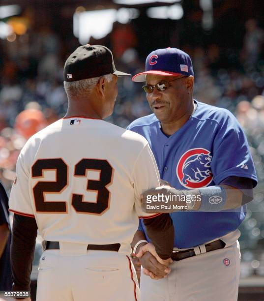 Felipe Alou manager of the San Francisco Giants greets Dusty Baker manager of the Chicago Cubs before their game at SBC Park on September 11 2005 in...